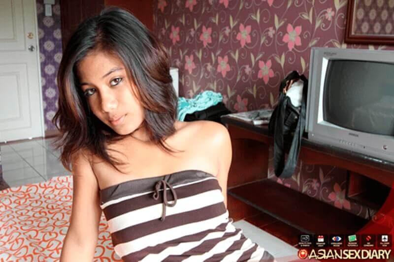 Foto von junger Asiatin mit große Brüste
